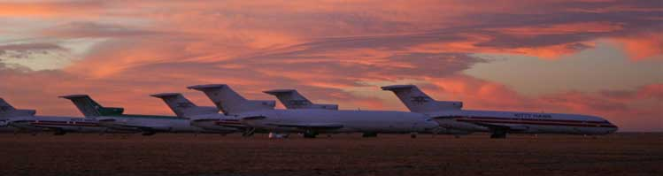 Airplanes on the tarmac at sunset